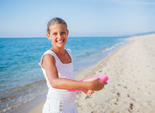 Girl playing frisbee Stock Images