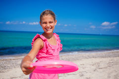 Girl playing frisbee Royalty Free Stock Images