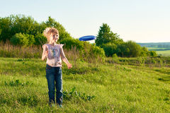 Girl playing frisbee in the park Royalty Free Stock Photography