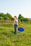 Girl playing frisbee in the park Royalty Free Stock Photo