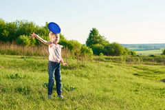 Girl playing frisbee in the park Royalty Free Stock Image