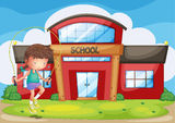 A girl playing in front of the school Royalty Free Stock Photo