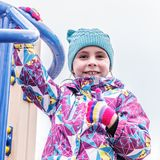The girl is playing fun on the playground. Stock Image