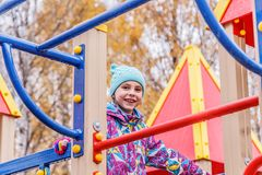 The girl is playing fun on the playground. Royalty Free Stock Image