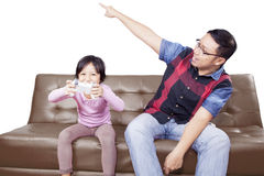 Girl playing game with angry father Stock Image