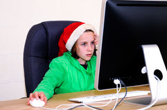 Girl playing game on computer Stock Photography