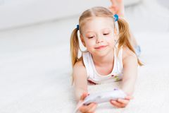 Girl playing on a game console Stock Image