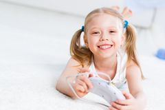 Girl playing on a game console. Have a fun Stock Photo