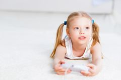Girl playing on a game console Stock Images