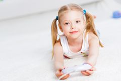 Girl playing on a game console Royalty Free Stock Photo
