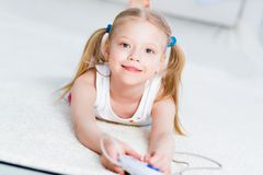 Girl playing on a game console Royalty Free Stock Image