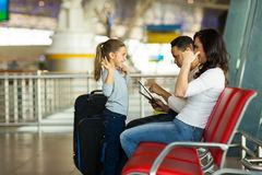 Girl playing game mother airport Stock Photo