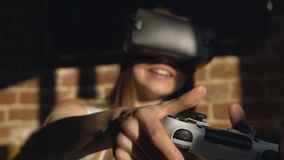 Girl playing game in vr glasses stock video footage
