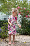Girl playing in the garden Royalty Free Stock Photography
