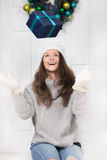 Girl playing a gift Stock Photography