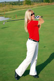 Girl playing golf Stock Images