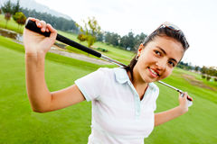 Girl playing golf Stock Image