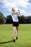 Girl playing golf on grass. Pretty girl playing golf on grass in summer Stock Photography