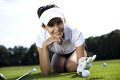 Girl playing golf. On grass in summer Royalty Free Stock Photography