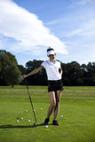 Girl playing golf on grass in summer Stock Photo