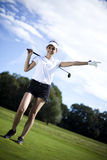 Girl playing golf on grass in summer.  Stock Photography