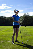 Girl playing golf Royalty Free Stock Images