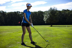 Girl playing golf on grass in summer. Girl playing golf, bright colorful vivid theme Royalty Free Stock Photo