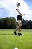 Girl playing golf on grass in summer. Girl playing golf, bright colorful vivid theme Stock Image