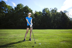 Girl playing golf on grass in summer. Girl playing golf, bright colorful vivid theme Stock Photos