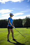 Girl playing golf on grass in summer. Girl playing golf, bright colorful vivid theme Royalty Free Stock Photos