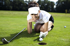 Girl playing golf on grass in summer. Thumbs up on golf, bright colorful vivid theme Stock Photo