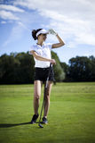 Girl playing golf on grass in summer. Thumbs up on golf, bright colorful vivid theme Royalty Free Stock Photo