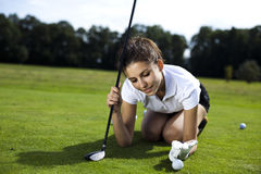 Girl playing golf on grass in summer Royalty Free Stock Images