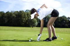Girl playing golf on grass in summer Stock Images