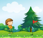 A girl playing golf in the hill Stock Photography