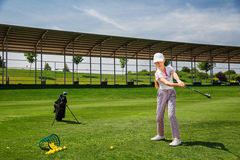 Girl playing golf Stock Photo