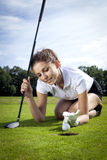 Girl playing golf. Pretty girl playing golf on grass in summer Stock Image