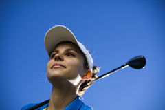 Girl playing golf. Thumbs up on golf, bright colorful vivid theme Royalty Free Stock Image