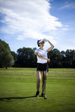 Girl playing golf. Thumbs up on golf, bright colorful vivid theme Royalty Free Stock Photos