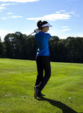 Girl playing golf. Thumbs up on golf, bright colorful vivid theme Royalty Free Stock Photography
