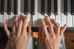 Girl is playing the grand piano. royalty free stock images