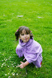 Girl playing on green grass Stock Photos