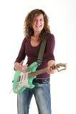 Girl playing guitar Stock Photos
