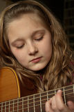 Girl playing guitar Royalty Free Stock Image
