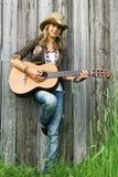 Girl playing guitar Royalty Free Stock Photo