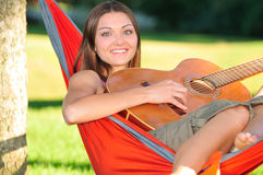 Girl playing guitar Royalty Free Stock Images