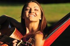 Girl playing guitar stock image