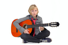 Girl playing guitar Royalty Free Stock Photo