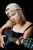 Girl playing the guitar Stock Photography