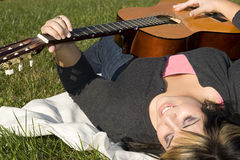 Girl Playing a Guitar Royalty Free Stock Photography